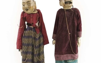 Two life-sized Burmese carved and painted wooden puppets