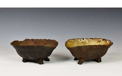 Two novelty Victorian cast iron dog bowls fashioned as inver...