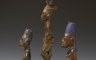 Yoruba, two Ibeji figures and a Shango staff,...
