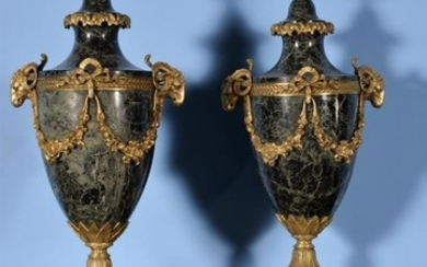 A pair of French green serpentine marble and gilt metal mounted urns in Louis XVI style