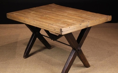 A 19th Century Tavern Table. The pine planked rectangular top with applied edging rails, standing on