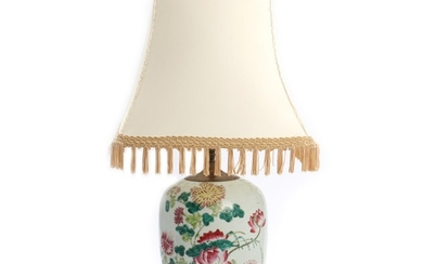 A 19th century Chinese porcelain jar, decorated with flowers. Altered into a table lamp. H. excluding base and mounting 27 cm.