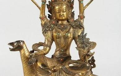 A CHINESE GILT BRONZE FIGURE OF A DEITY SEATED ON A