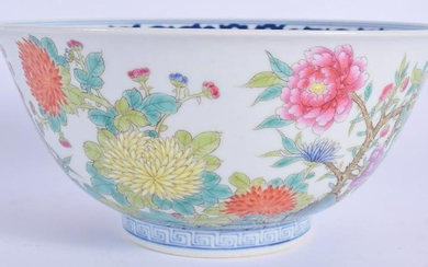 A CHINESE PORCELAIN FAMILLE ROSE BIRD BOWL. 16 cm wide.