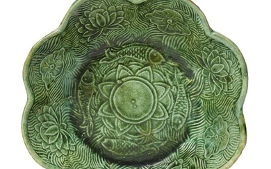 A Chinese green-glazed pottery 'lotus pond' lobed bowl, Liao dynasty,...