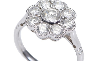 A DIAMOND RING-Of floral cluster design, centred with a round brilliant cut diamond weighing 0.50cts, within a surround of eight fur...