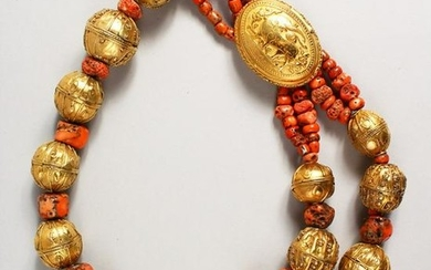 A LARGE SILVER GILT AND CORAL NECKLACE with an oval
