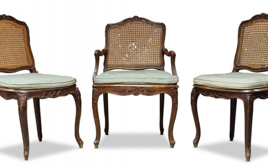 A Louis XV beech and caned fauteuil,...
