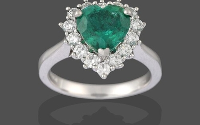 A Platinum Emerald and Diamond Cluster Ring, the heart shaped...