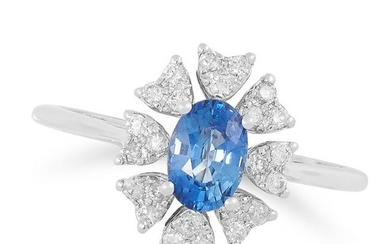 A SAPPHIRE AND DIAMOND CLUSTER RING set with an oval