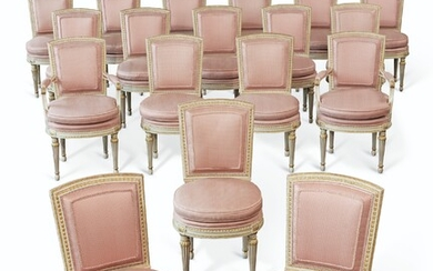 A SET OF EIGHTEEN FRENCH WHITE-PAINTED AND PARCEL-GILT MAHOGANY DINING CHAIRS, CIRCA 1900