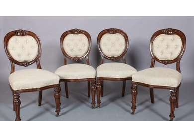 A SET OF FOUR VICTORIAN MAHOGANY DINING CHAIRS each having a...