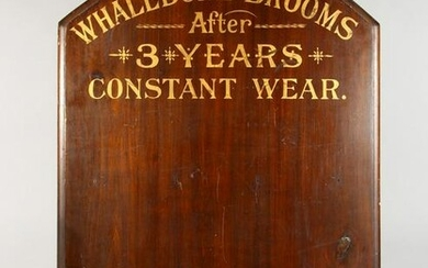 A STAINED WOOD ADVERTISING BOARD, with gilt lettering