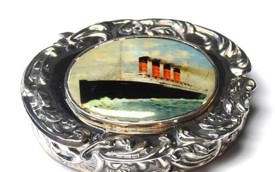 A STERLING SILVER AND ENAMEL OCEAN LINER PILL BOX The scroll...