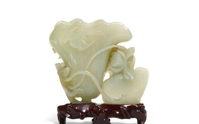 A carved jade lotus and bird group