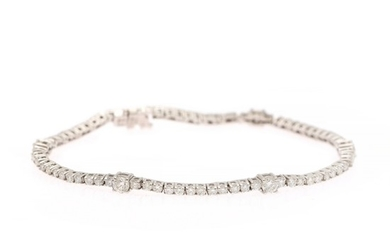 A diamond bracelet set with numerous brilliant-cut diamonds weighing a total of app. 3.00 ct., mounted in 18k white gold. G-H/SI-P1. L. 17.8 cm.
