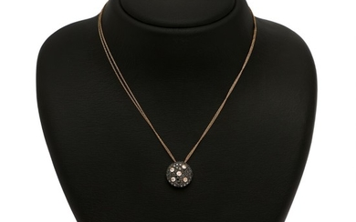 A diamond pendant set with five rose-cut and numerous black diamonds, mounted in 18k partly black rhodium plated rose gold. Accomapanied by chain of 18k gold.