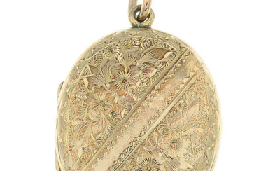 A locket, with engraved clover detail.