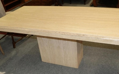 A modern travertine pedestal dining table, together with a modern...