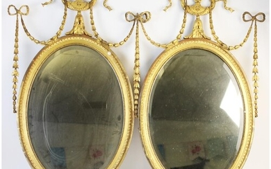 A pair of 19th century gilt wood and gesso oval wall mirrors...