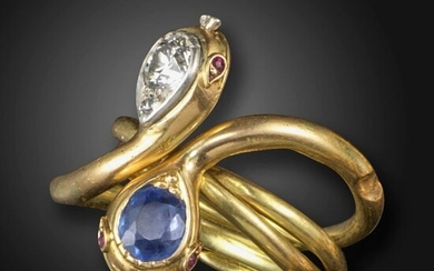 A pair of Victorian sapphire and diamond gold interlocking snake rings, set with a cushion-shaped sapphire or an old circular-cut diamond to the serpent's head, with ruby eyes in silver and gold, can be worn individually or together as one intertwining...