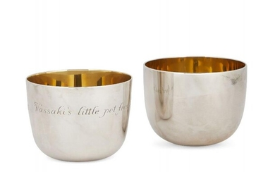 A pair of silver tumblers with gilt...