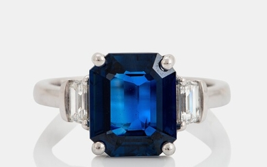 A platinum ring set with a step-cut sapphire weight 4.58 cts