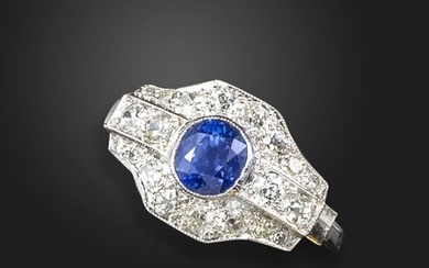 A sapphire and diamond dress ring, set with an oval-shaped sapphire within geometric border pave-set with old circular and single-cut diamonds in white gold, size M ½
