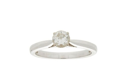 A single stone diamond set ring claw set with a...