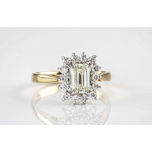An 18ct gold and emerald cut diamond cluster ring, the centr...