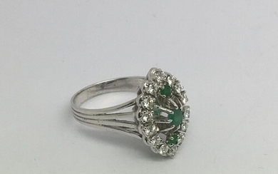 An 18ct white gold, diamond and emerald marquis shape cluste...