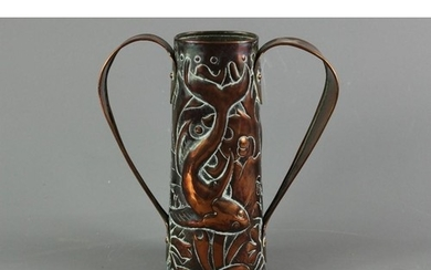 An Arts and Crafts copper jug; the jug having double handles...