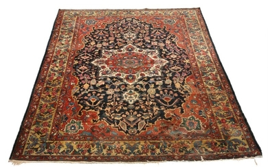 "An antique Bakthiari ""palace carpet"", classic angular medallion design on blue base. 20th century first half. 428×340 cm."