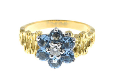 An aquamarine and diamond floral cluster ring.