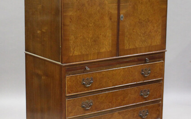 An early/mid-20th century burr walnut tallboy, fitted with a cupboard above a slide and four drawers