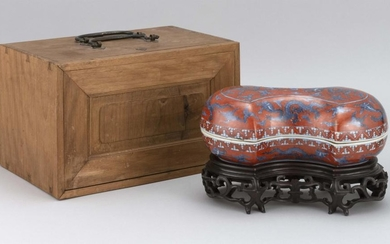 CHINESE IRON RED AND BLUE PORCELAIN BOX In double ax-head form, with decoration of five-clawed dragons chasing a fiery pearl. Six-ch...