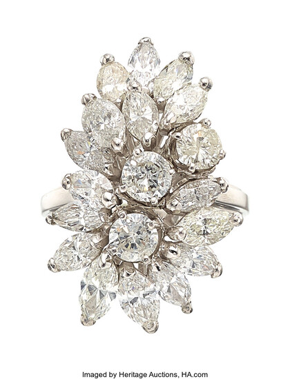 Diamond, White Gold Ring The ring features marquise-shaped diamonds...