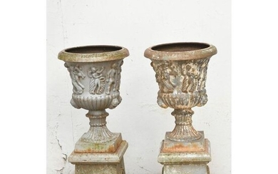 PAIR OF CAST IRON MEDICINAL VASES presented on...