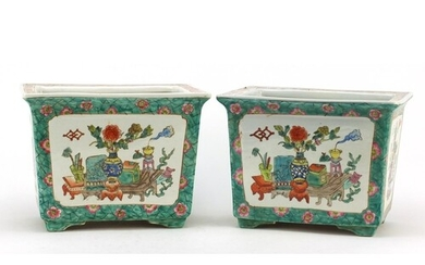 Pair of Chinese porcelain planters, each hand painted in the...