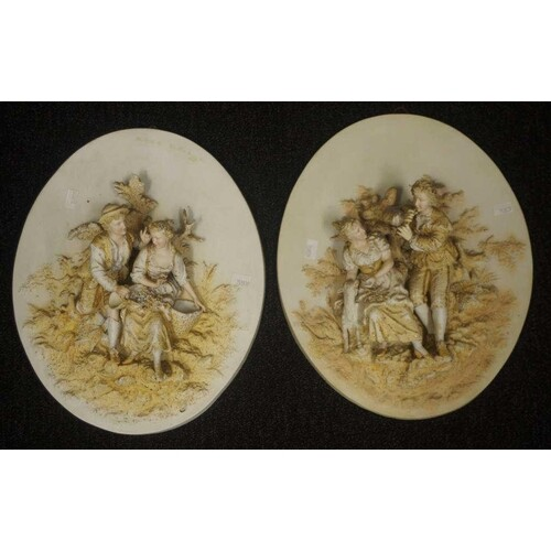 Pair of Continental courting couple wall plaques bisque cera...