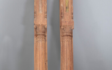 Pair of Hindu columns in carved wood, 19th Century.