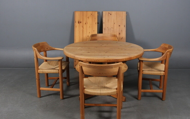 Rainer Daumiller. A set of four armchairs and a dining table in pinewood