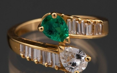 Ring You and Me mounted on 18 Kt yellow gold with pear-cut diamonds, emerald and baguette with pear-cut emerald.