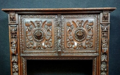 very important Renaissance style fireplace in walnut with brown patina
