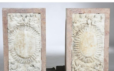 2 Pink granite SOCLES decorated with a Louis XIV white marble plaque with a sun in its center and framed with different allegories and divinities. The marble plates are late 17th century. (1 missing from a base). 45x23 Plinths 52x30x28.