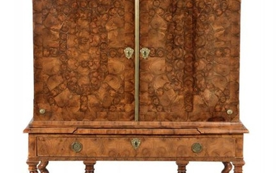 **LOT WITHDRAWN**A Charles II walnut and olivewood oyster veneered cabinet on stand