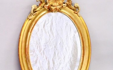 A 19TH CENTURY GILT FRAMED OVAL WALL MIRROR, with shell