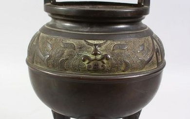 A 20TH CENTURY CHINESE BRONZE TWIN HANDLE CENSER, with