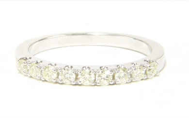 A 9ct white gold half eternity ring
