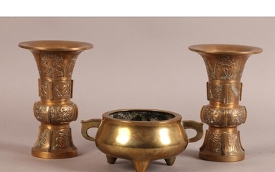 A CHINESE BRONZE TWO HANDLED CENSER of compressed cauldron f...